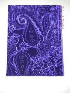 Handmade blank journal with purple spandex velour cover. Made by Roxanne