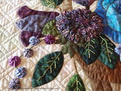 """""""Infinity"""" detail of center block  made by Joan Anderson ad machine quilted by Margie Kraft."""