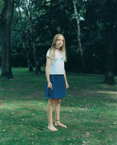 Rineke Dijkstra A Retrospective.  Tiergarten, Berlin, Germany, June 27, 1999: The series of portraits Dijkstra made over a period of years of kids in Berlin's Tiergarten park sometimes make them seem to be hesitating at the threshold of their own maturity.  See Dijkstra's work here on LightBox.