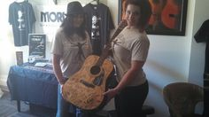 Some models with The EA Kroll Autographed Guitar