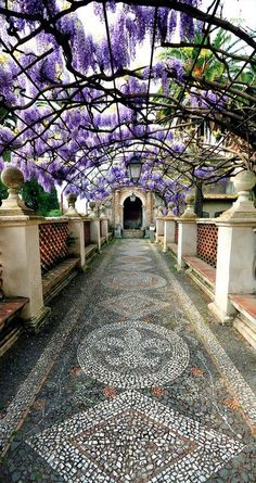 Wisteria-covered passage at Villa d'Éste, Tivoli, Italy (by Capitan Mirino). Nothing so glamorous, but I love the mosaic path with wisteria. Beautiful World, Beautiful Gardens, Beautiful Places, Beautiful Boys, Beautiful Flowers, Places To Travel, Places To See, Travel Destinations, Travel Deals