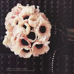 nosegay with 12 anemones with cream sweet pea, ranunculus and peonies all light pink, light pink stem wrap and diamante pins