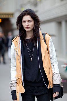 An edgy studded jacket maintains lightness in neutral hues.   - HarpersBAZAAR.com