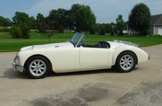 This 1962 MGA is as a matching numbers example on offer by its third owner who has enjoyed the car for 25 years. He wanted a mildly modified but period correct roadster and commissioned a full restoration in 2008. The original 1622cc engine was rebuilt using 1800cc pistons and a mild racing cam for