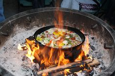 Dutch oven jumbalaya over a campfire. Camping food recipe