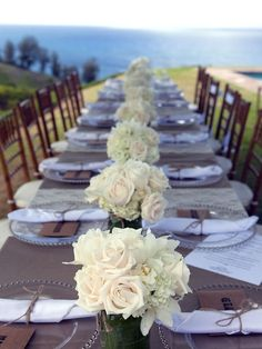 kauai wedding table- I absolutely love and always suggest to brides using either all long tables or a mix of long and circular. I just love the family feel to it.