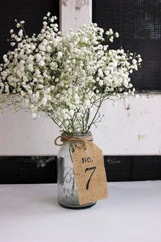 Burlap wedding table centerpieces table number ideas / http://www.deerpearlflowers.com/rustic-wedding-ideas-with-burlap-touches/