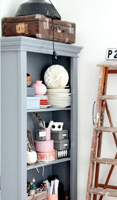 PAINT THE SMALL DOORLESS BOOK CASE BETWEEN TWO BIG ONES A GREAT COLOR