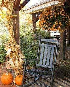 Fall decorated porch. This looks like our front porch! I love to decorate with corn stalks!