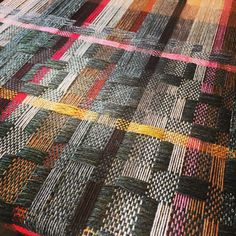 Handwoven in lambswool using deflected double weave pattern.