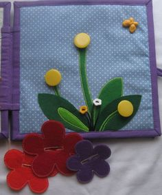 Put the flowers on the buttons. I like the button holes in the flowers.
