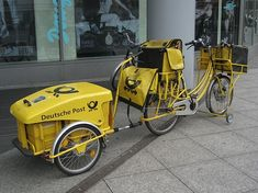 Ran across these photos on the web of Deutsche Post using bicycles for inner city delivery.
