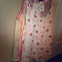 4 Crop Tops for $10!✨✨✨✨ 4 crop tops ALL for $10! All in good condition. Two are spaghetti straps and the other two are tank tops. The orange with flowers is a size Large. The polka dot one is a Large as well. The pink flowery one is a Medium and so is the Aztec looking tank. a'gaci Tops Crop Tops