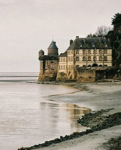 water, sea, chateau, beach. Reminds me of the little mermaid & Prince Eric's castle!