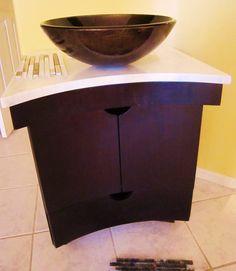 Vanity cabinet for tortoise shell vessel sink