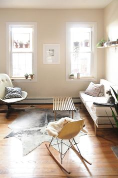 Living room interior. Plycraft lounge chair, Eames fiberglass rocker, Daybed by Michael Yarinsky and Pat Kim.