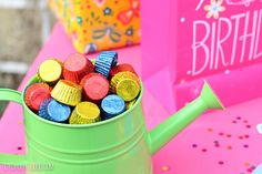 Use a watering can for a candy dish for a children's garden party - so cute!