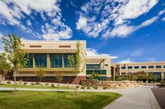 PHOTO TOUR: University of Colorado Health Poudre Valley Outpatient Cancer Center | Healthcare Design --- The new addition (shown in the foreground) features large windows that flood the medical infusion area with natural light and views to the landscaping and the distant front range of the Rocky Mountains. Photo: Bob Soman Photography