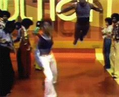"This dude is basically skydiving onto the dance floor and it's SO RIGHT. | 18 Joyful ""Soul Train"" Dancing GIFs That Will Make Your Day"