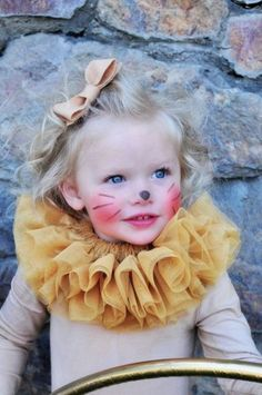 Cute lion / lioness costume with tulle neck detail and the most aforable bow in her hair