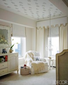 cute nursery with a painted ceiling