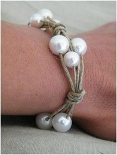 hemp and pearl bracelet 4-5 strings of hemp, tie them together.   2 times your wrist size, String three pearls onto three different strands.  Tie a knot, repeat.  Continue until you reach the end of the bracelet.  Leave enough space at the end to tie the bracelet once it's on your wrist.  You can also make a toggle style clasp.