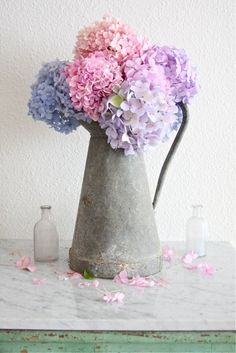 I <3 Hydrangeas! And I have a collection of vintage small glass bottles like they one. :)