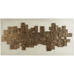 Crafted entirely by hand, our indoor/outdoor 3-D wall art is a striking combination of an antiqued golden metal sculpture set atop painted canvas. Both the design and impressive size make it versatile, so you can hang it vertically or horizontally depending on your space. An all-weather lacquer seals the deal.