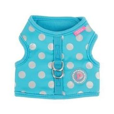 Chic Pinka Dog Harness by Pinkaholic - Blue. Your pup will look adorable with the Chic Pinka Dog Harness by Pinkaholic in Blue!  Polka dot pattern and solid schemed Touch fastener closure at neck and chest Decorated with Pinkaholic rubber label Shell: 100% polyester Lining 100% cotton Why We Love It:The Chic Pinka Dog Harness by Pinkaholic is a polka dot patterned and solid schemed harness. The neck and chest on the harness close with touch fasteners. Decorated with a fun Pinkaholic…