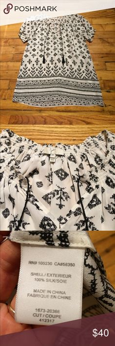 Joie blouse 100% silk black & white cap-sleeve blouse by Joie. In mint condition with no signs of wear. Joie Tops