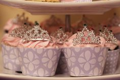 Gorgeous tiara topped cupcakes at a Sofia the First party!   See more party ideas at CatchMyParty.com!  #partyideas #sofiathefirst