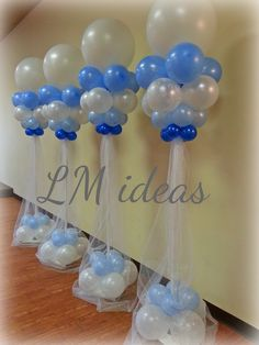 beautiful and elegant. 9 ft blue and white balloon columns with sparkling tulle