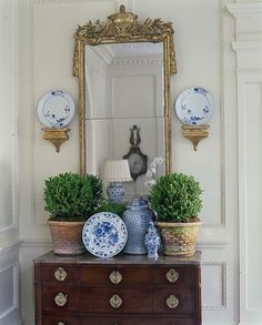 A Flair for Vintage Decor gold mirror, blue& white, boxwood? would usually think this is too cluttered but it works