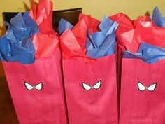 Spiderman birthday party favor bags.. I'll make the eyes bigger and draw black web. Good idea with red bag