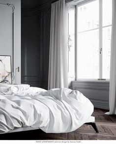 Minimal classical bedroom with grey walls with beautiful mouldings