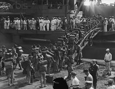 Marines On Boat Headed For Haiti: Original caption: 1915-Philadelphia, PA: Marines boarding the U.S.C Conneticut at League Island Navy Yard, Philadelphia, July 31, when 500 of them sailed for Port-Au-Prince, Haiti, to assist in disarming the unruly natives.   http://www.usmilitariaforum.com/upgradetest/index.php?/topic/3191-virtual-campaign-library-haiti-1915-1934/page__st__40