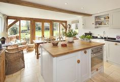 Kitchen/dining area in extension. Oak frame with glazed doors