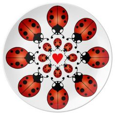 Two circles of eight lucky ladybirds or ladybugs around a red heart, porcelain plates for hors d'ouevres or display. Ladybugs are associated with harmony, grace, wishes come true, academic or career achievement, magical protection and prosperity. If a ladybug lands on you, when she takes off she'll fly in the direction of your true love. If a ladybug enters your home, she brings blessings of good fortune, happiness and love.