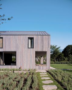 House in Amagansett is a two-storey residence surrounded by grassy areas and trees, in the hamlet of the same name on Long Island's south shore.