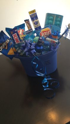 Blue themed men's gift basket filled with goodies! Blue themed men's gift basket filled with goodies! Blue themed men's gift basket filled with goodies! Blue themed men's gift basket filled with goodies! Homemade Gift Baskets, Valentine's Day Gift Baskets, Themed Gift Baskets, Raffle Baskets, Cute Boyfriend Gifts, Boyfriend Gift Basket, Boyfriend Anniversary Gifts, Cute Birthday Gift, Birthday Gift Baskets