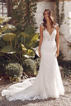 This fit and flare gown is all about classic elegance. The embroidered lace is detailed with an underlay of metallic threaded faux lace. The plunge illusion bodice and keyhole back add a touch of sexiness to this look. This style is also available with the front bodice lined to the side seams.