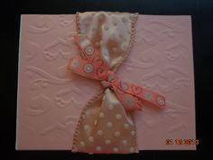 Pink Embossed Background with Pink Dotted Ribbon
