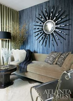 love the color combo, mirror, sofa, and lamp!