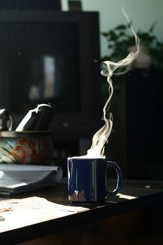 fresh steamy hot coffee accompanied by the first light of the day. even better with complete silence