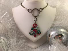 A personal favorite from my Etsy shop https://www.etsy.com/listing/250647404/colorful-christmas-tree-pendant-necklace
