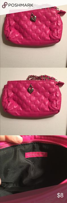 Victoria secret pink bow make up bag Victoria secret pink about make up bag with heart locket on front. Never used but was stored away with other bags PINK Victoria's Secret Bags Cosmetic Bags & Cases