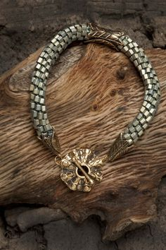 Kumihimo braid with hex beads. Clasp, spacer and cones from http://www.handfast.biz