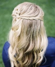 Cute wavy hairstyle with braided crown