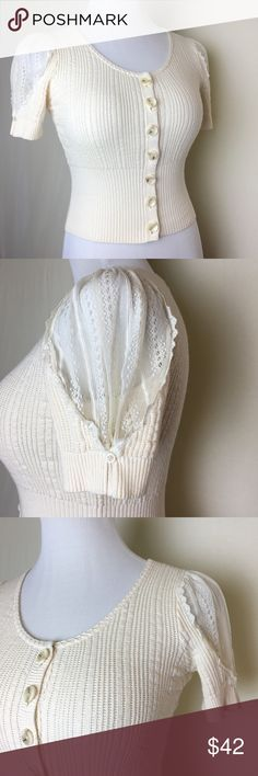 Sweet Knitted & Knotted lace sleeve cardigan Possibly the cutest cardigan in creation. Cream cropped cardigan with ribbed waist, scoop neck and lace sleeve inserts. Button up with snap above top button. In excellent like new condition. Anthropologie Sweaters Cardigans