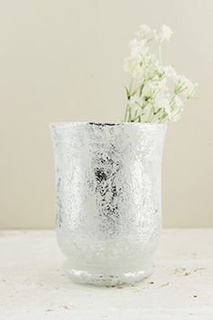 This Mercury Glass Hurricane Vase in Frosted Silver has a beautifully textured silver coating and elegant curves. It measures approximately wide and tall, and can be filled with either a delicate floral arrangement, or a small votive candle Mercury Glass Candle Holders, Tall Glass Vases, Blue Glass Vase, Votive Candles, Hurricane Vase, Dappled Light, Save On Crafts, Vase Fillers, Floating Candles
